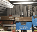 10x45 online storage unit filled with flat-screen TVs and other new merchandise in boxes.