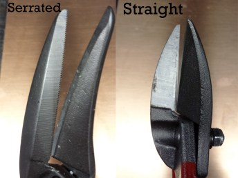 Notices the small notches in the serrated blades.