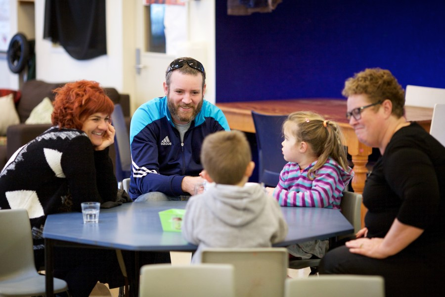 Educator having conversation with parents and children