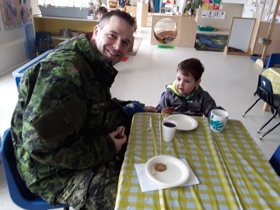 MIlitary father eating with son