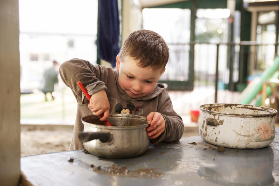 Boy mixing in pot