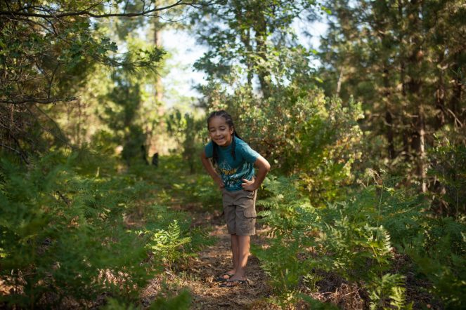 young boy walking on a nature trail