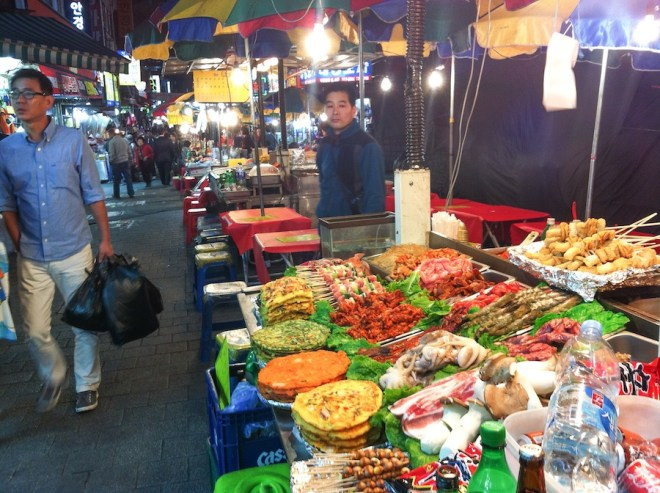 Multiple street vendors lined up at Namdaemun Market.