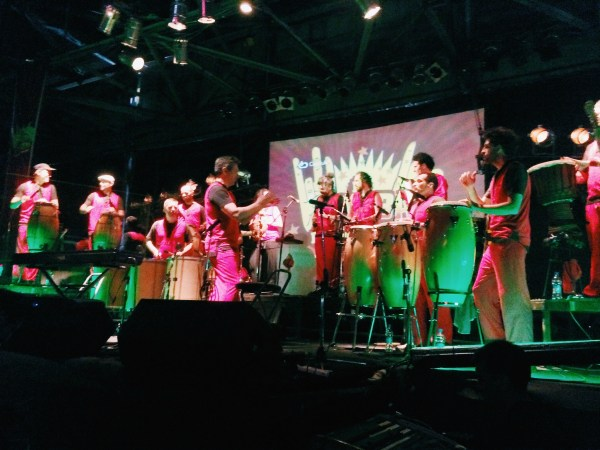 La Bomba de Tiempo, a popular drum show, fills the night with infectious energy through its unique musical spectacle.
