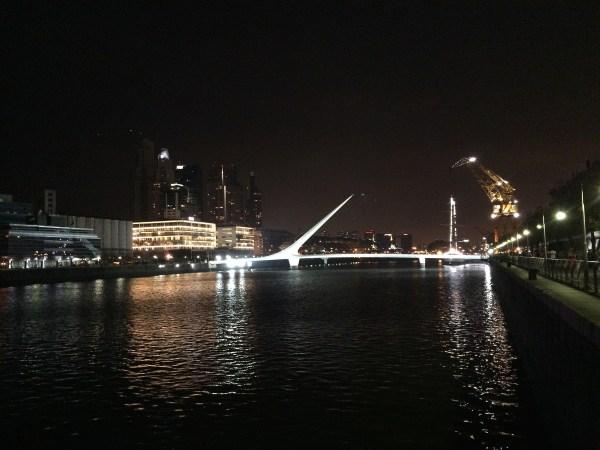 The famous Puente de la Mujer bridge lit up at night.