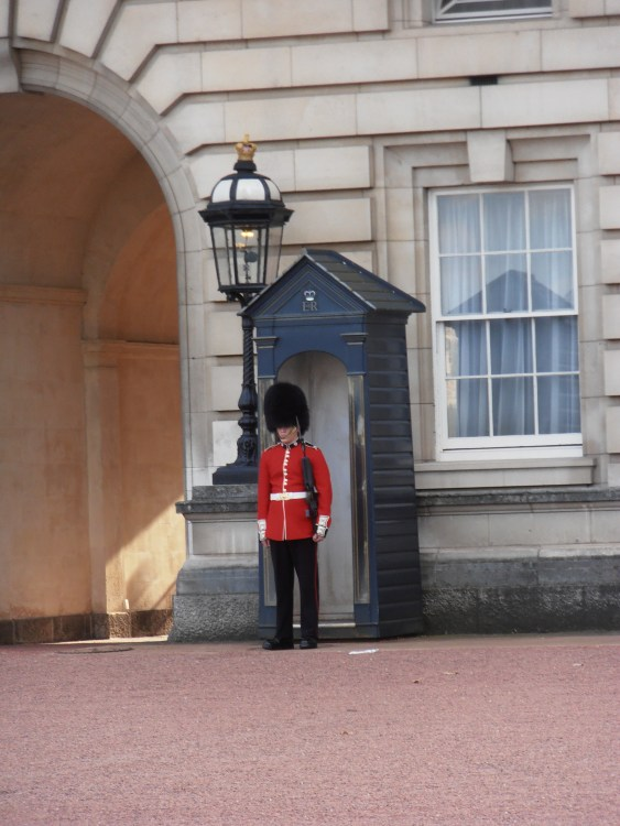 A loyal Grenadier Guard protecting the queen's residence