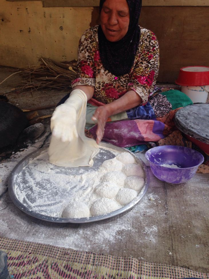 A local from Ghor showing the ISA group how to make bread!