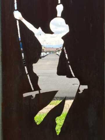 Metal Art Swinging Girl