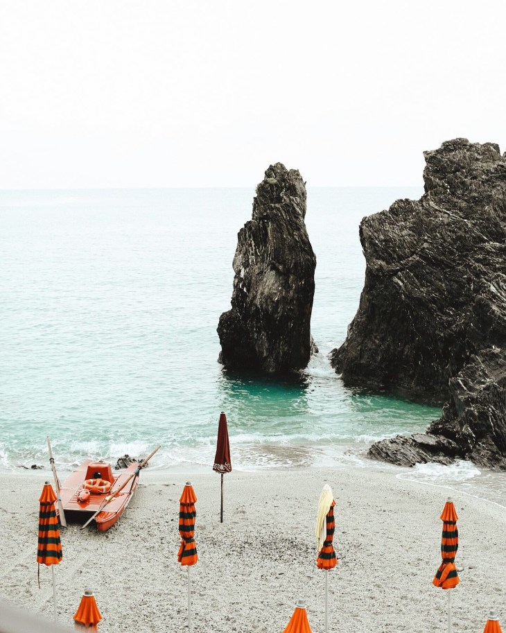umbrellas on beach in cinque terre