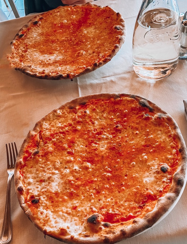 two pizzas in eric's pizzeria sirmione