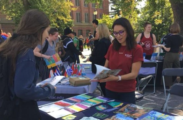 An ISA Global Ambassador working a booth at a study abroad fair.