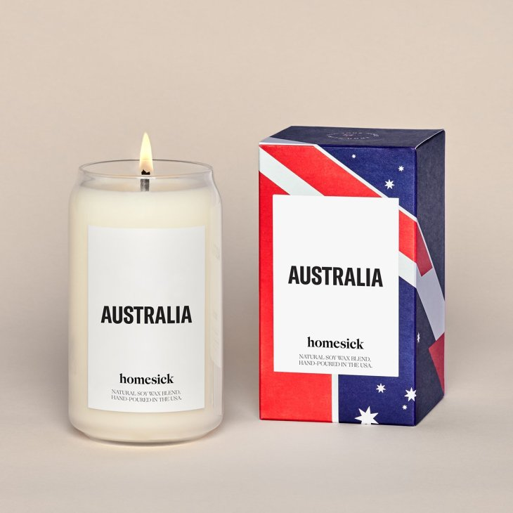"White candle with label that says ""Australia"", as well as box with Australian flag"