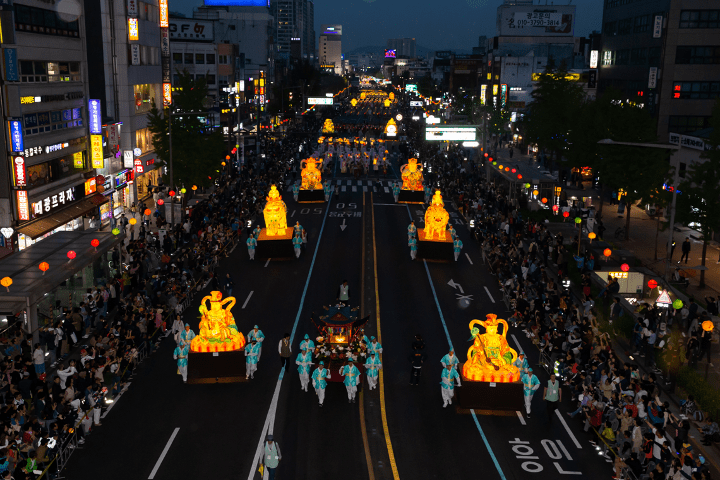 Lit parade floats coming down street in street parade in Seoul