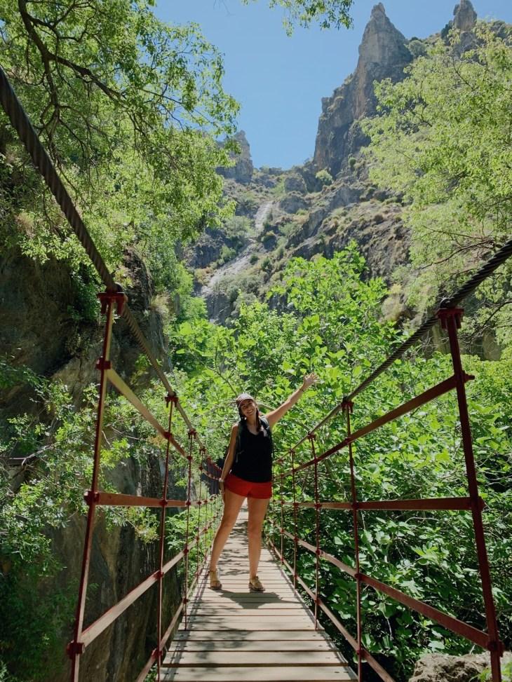 Girl on drawbridge in Sierra Nevada Mountain Range