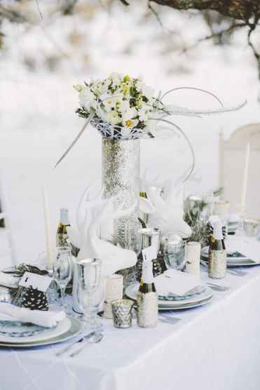 a white winter wonderland wedding table decorations