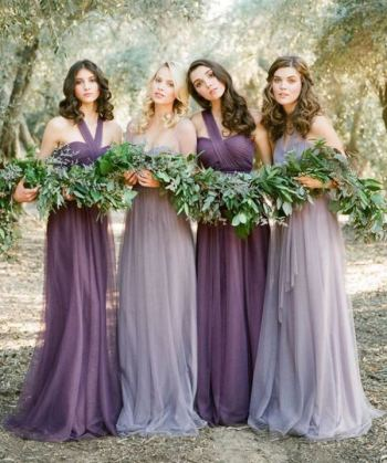 bridesmaids in shades of purple for a spring wedding
