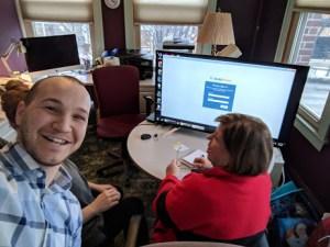 Matthew working with two women at customer's studio