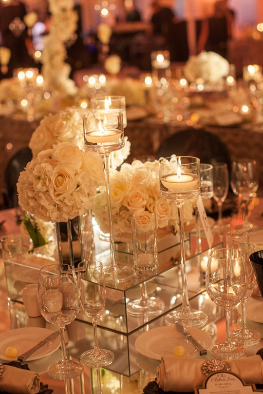 White Roses And High Candles Wedding Centerpiece