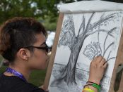 Student drawing tree outside