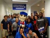 New students posed with mascot Senator Sam