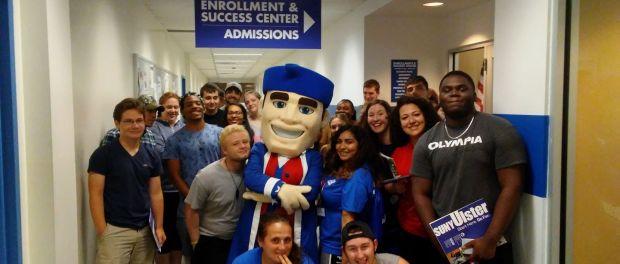 New students posed with mascot Senator Sam