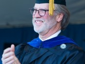 Vice-President and Dean of Academic Affairs Kevin Stoner clapping at graduation ceremony