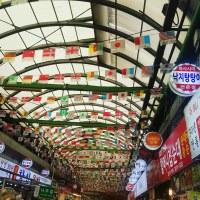 Flags flying on the ceiling of Gwangjang Market