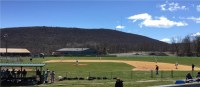 A baseball field with a background of the shawangunk mountains