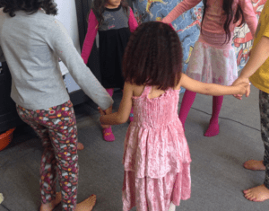 Children dance in a circle