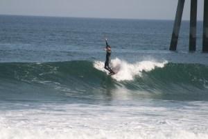 Evan Micele surfing a longboard in Virginia Beach.