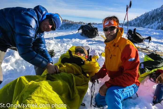 Chris and Marc packaging Francie in an Alpine Threadworks sled.  Simple, quick and a guide favorite on the tests.