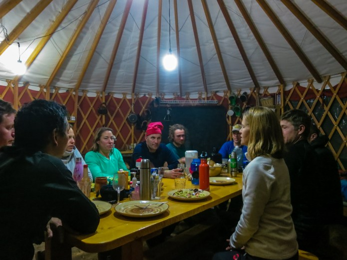 A warm yurt, good friends, yummy food and plenty of powder skiing make for a perfect evening in the backcountry