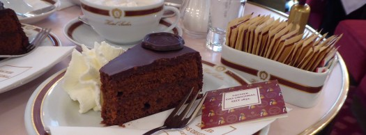 Enjoying the famous Sachertorte at the Hotel Sacher in Vienna