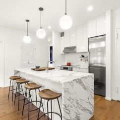 Kitchen Islands Clearance Kitchenaid A Waterfall Counter In Calacatta Gold Marble Shines ...