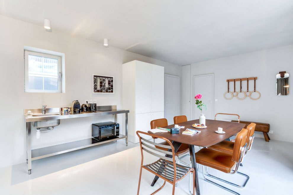 vintage sport details decorate the dining room of this urban loft in south Paris by Sweet Inn
