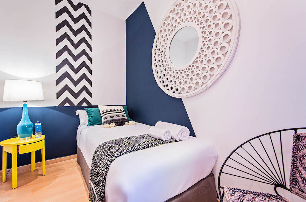 geometric patterns for the bedrooms in this quiet Vicky Christina apartment in the center of Barcelona by sweet inn