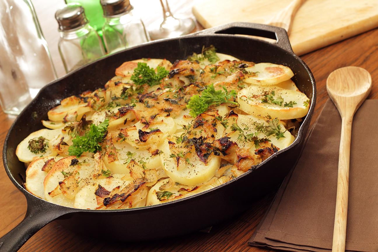 potato gratin in cast iron dish