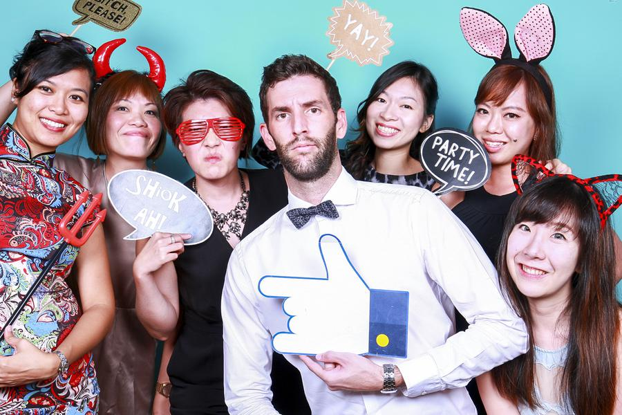 A group of 7 people dressed in party-wear posing for the camera
