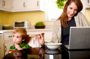 woman taking care of household tasks simultaneously
