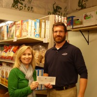 Ivens presents a donation to Natalie Dresen at the Waunakee Food Pantry