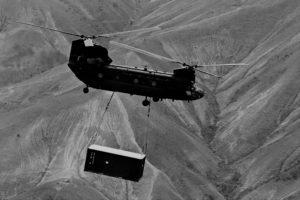 Photo of a Chinook helicopter carrying a shipping container