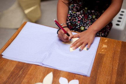 Tracing flower petals on tissue paper.