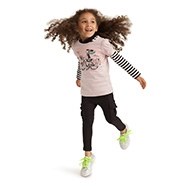 Girl jumping in cycle chic tshirt