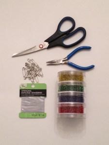 Supplies for diy safety pin bracelet.