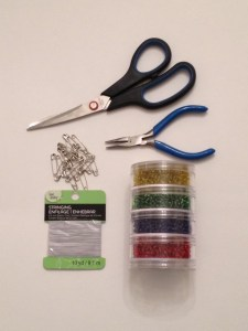 Supplies for diy safety pin bracelet.