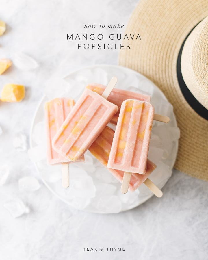 Stack of mango guava popsicles on top of plate of ice next to straw hat