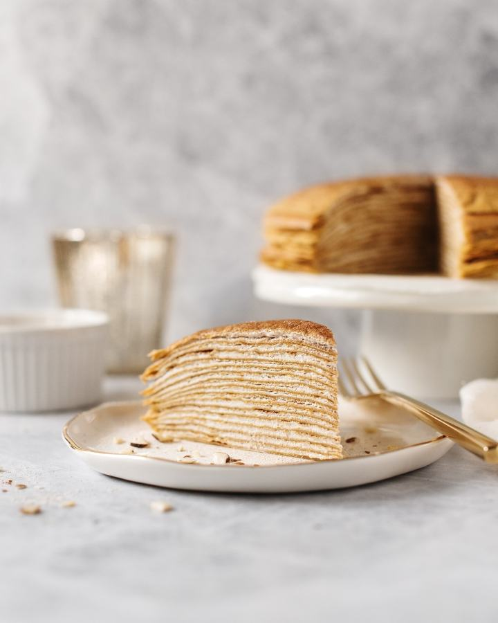 Side shot of all the layers of a slice of pumpkin crepe cake