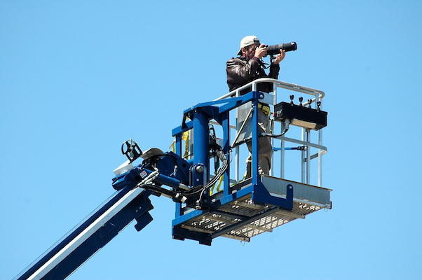 Photographer on a crane