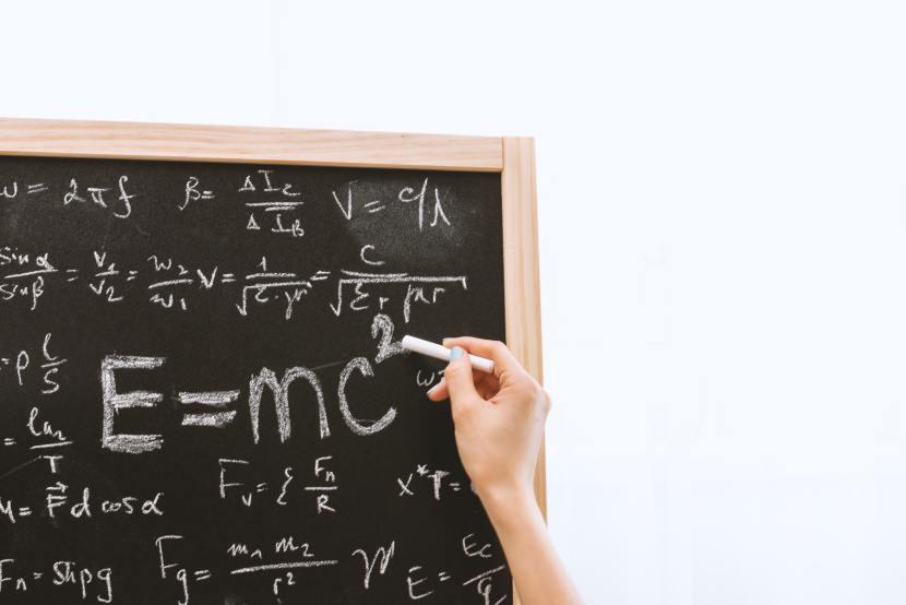 doing math on a chalkboard