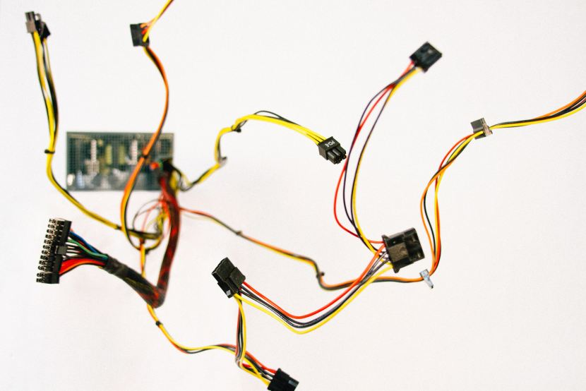 Microcontroller with wires and connection pins swirling from it